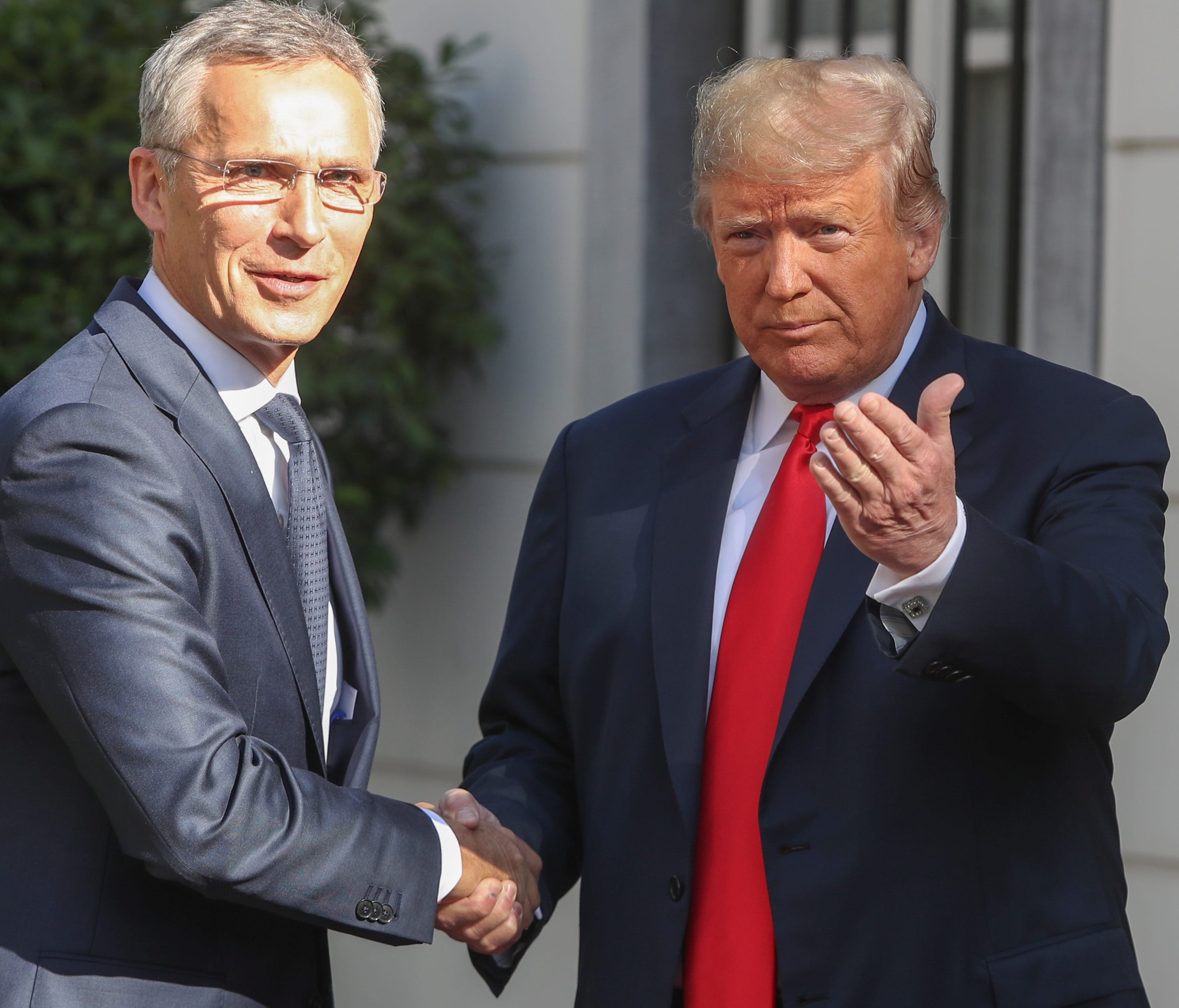 NATO Secretary General Jens Stoltenberg (left) and President Donald Trump meet ahead of a NATO Summit at the US Embassy in Brussels, Belgium.