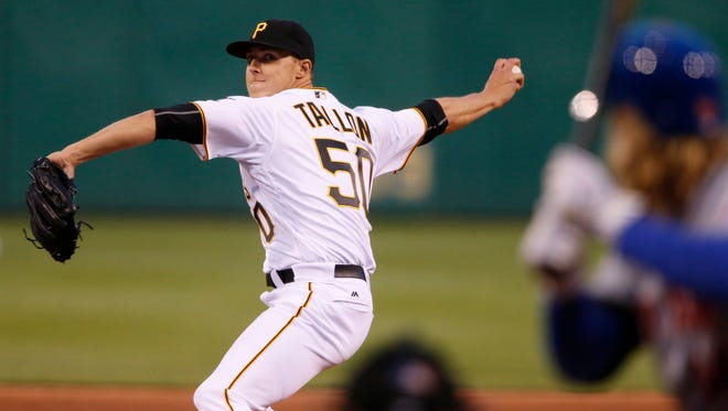 Pittsburgh Pirates starting pitcher Jameson Taillon delivers in the fifth inning of a baseball game against the New York Mets in Pittsburgh, Wednesday, June 8, 2016. It is the Taillon's major league debut. (AP Photo/Gene J. Puskar)