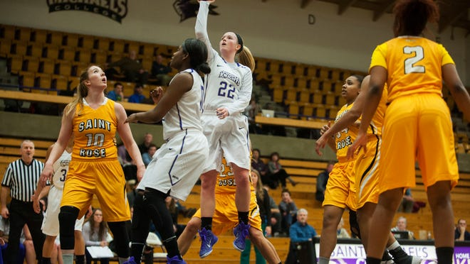 St. Michael's Megan Gaudreaiu (22) leaps to take a shot during the women's basketball game between the St. Rose Golden Knights and the St. Michael's Purple Knights on Wednesday night.