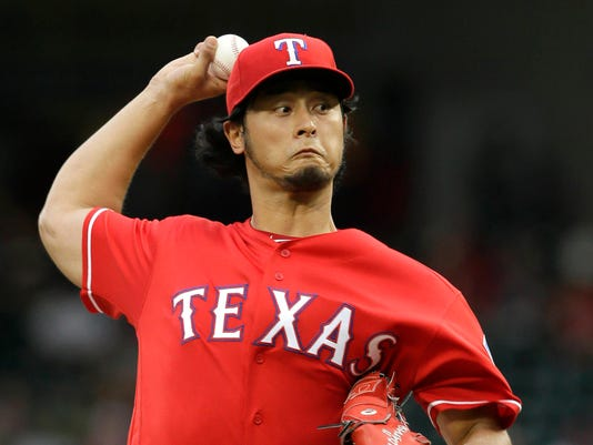 Texas Rangers starting pitcher Yu Darvish throws during the first inning of a baseball game against the Oakland Athletics in Arlington, Texas, Wednesday, July 27, 2016. (AP Photo/LM Otero)