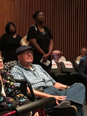 Walter Smith, 67,(seated) and Anide Francis (standing in foreground), shared their concerns about the future of health care in the U.S. at a town hall meeting held by U.S. Rep. Steve Cohen, D-Tennessee.