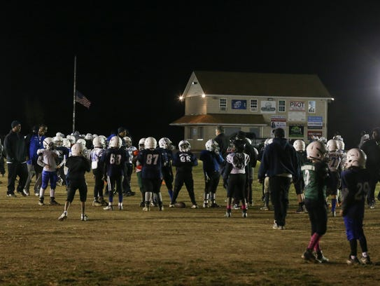Dozens of players take part in youth football practices at the MOT Sports Complex in Middletown. The football club is hosting two regional tournaments each of the next two weekends that will bring in 62 out-of-state teams.
