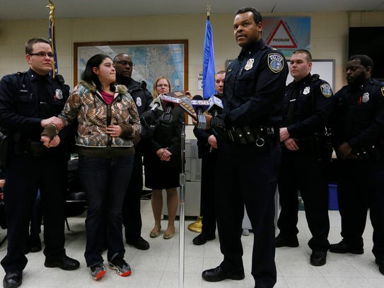 Milwaukee Police Captain Jutiki Jackson thanks the family of Laylah Petersen on behalf of the Police Department for a plaque on Jan. 5, 2015.