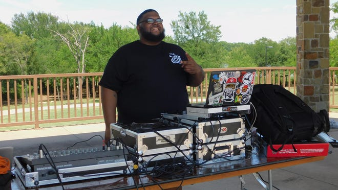 A DJ plays during Saturday's Juneteeth celebrations in Pecan Grove Park.