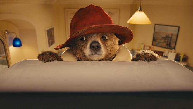 Paddington, voiced by Ben Whishaw, gets his sweet due in the film.