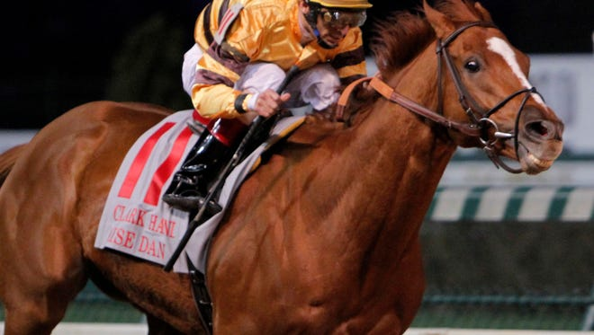 Wise Dan, with jockey John Velazquez aboard, rolls to victory in the $500,000 Clark Handicap (Gr. I) horse race at Churchill Downs in Louisville, Ky., Friday, Nov. 25, 2011. (AP Photo/Garry Jones)