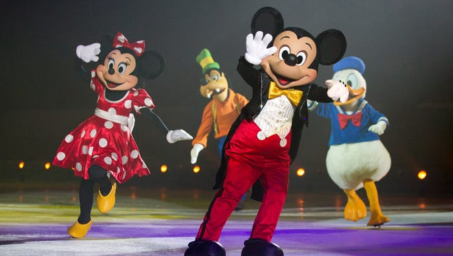 """Mickey and Minnie skate back onto the Resch Center ice for Disney on Ice's """"Dare to Dream"""" Feb. 10-12."""