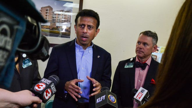 Governor Boby Jindal visits University Hospital & Clinics on Wednesday. David Callecod, right, joined him at a news conference.