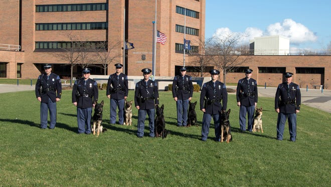 Six German Shepherds and their handlers have graduated from basic training to help the Michigan State Police hunt for illegal drugs and missing people.