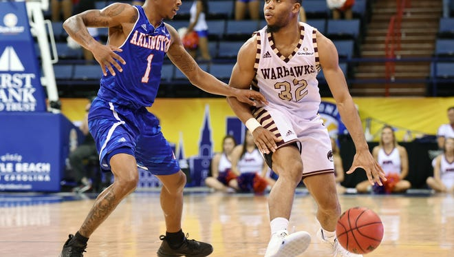 ULM's guard duo of senior Justin Roberson (32) and junior Nick Coppola face the Little Rock tandem of senior Josh Hagins and junior Marcus Johnson Jr in the Sun Belt championship game on Sunday at noon.