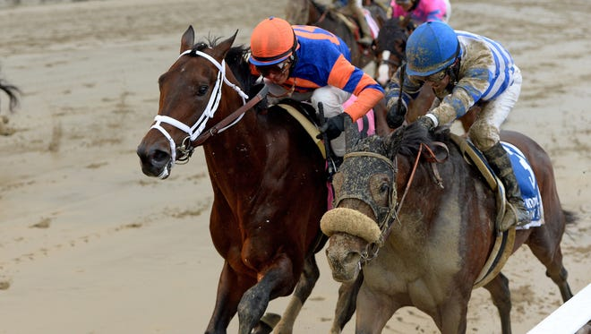 Outwork, outside, beat Trojan Nation to the wire in Saturday's Wood Memorial.
