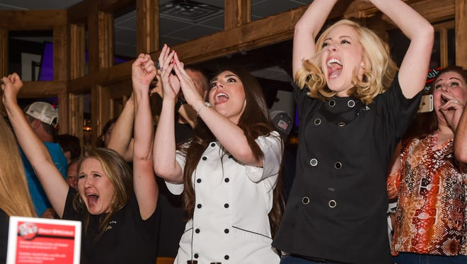"Fallon Bearb, left, and Kayla Trahan cheer as they're announced as the winners of Food Network's ""Cake Wars"" during a June viewing party held at Pete's."