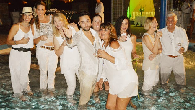 On the eve of Swinging Fore Healthcare, from left,  Grace O'Conner waded into the fun of the White Haute Party hosted by the Jackson Hospital Foundation with Marissa Weber, Mary Bonikowski, Madison Faile, Jenny Brown, Arla Chandler, Sherri Turenne, Sharon Goodison and Derek Parrish (Contributed)