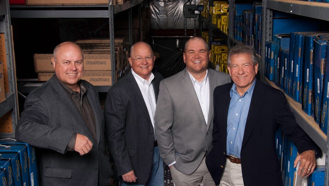 From left, Dick Hedahl, president and CEO of Hedahls; John Bartlett, executive chairman of APH; Corey Bartlett, APH president and CEO; and Larry Lysengen, COO of Hedahls; pose for a photo after the completion of the APH acquisition of Hedahls Inc.