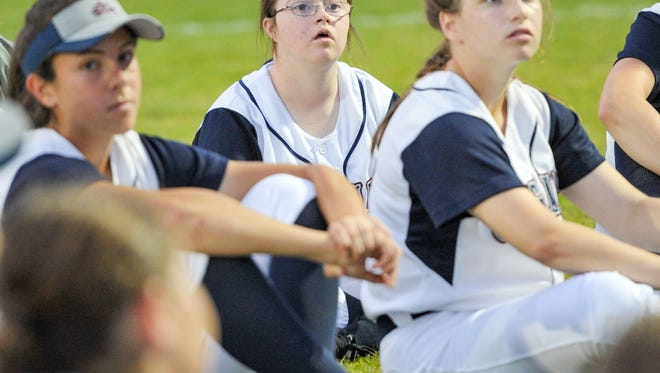 Janie Girourard is team manager for the St. Thomas More softball team.