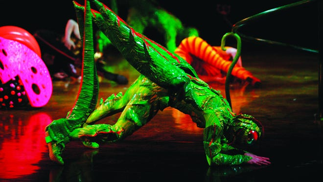 """Cirque du Soleil's """"OVO"""" is populated by an imaginative civilization filled with colorful insects designed by noted costume designer Liz Vandal. Here is one of the most recognizable of them, an oversized cricket."""