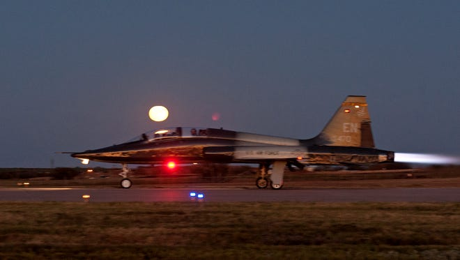 An air crew from the 80th Flying Training Wing takes off during the night with the moon shining brightly above them as they practice night training in a T-38 Talon on Nov. 6, 2014, at Sheppard Air Force Base, Texas. Pilots practice take offs, landing, touch and goes to better prepare themselves for night time flying.