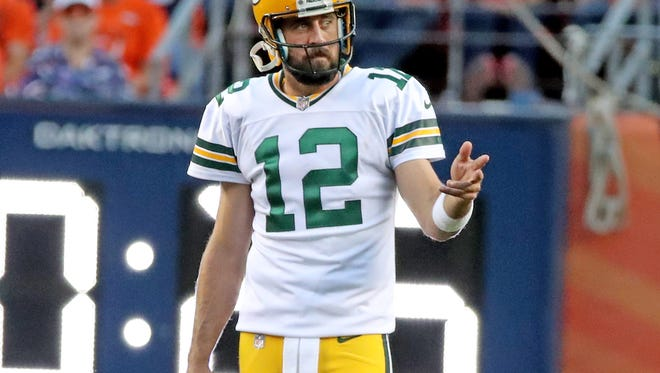 Green Bay Packers quarterback Aaron Rodgers (12) gestures during the game against the Denver Broncos Saturday, Aug. 26, 2017 at Mile High Stadium in Denver.