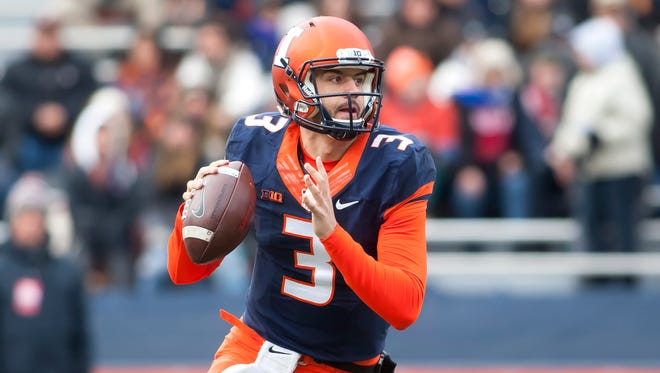 Illinois Fighting Illini quarterback Jeff George Jr. (3) sets up to pass against the Indiana Hoosiers during the first quarter at Memorial Stadium.