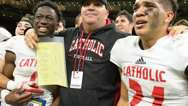 Catholic High of New Iberia coach Brent Indest, shown here celebrating last year's Division III state championship, is totally on board with the LHSAA's current system of determining home teams in the postseason.