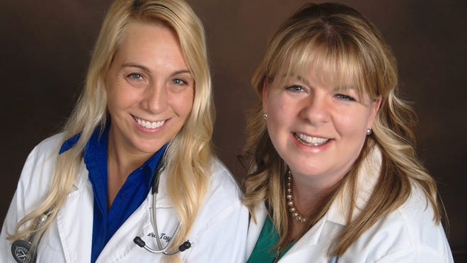 Tara Taylor (left) and Stacy Waack offer patients memberships in their new direct pay primary care practice in Milford.