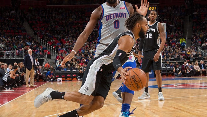 Spurs guard Patty Mills drives to the basket in front of Pistons center Andre Drummond in the first half on Saturday, Dec. 30, 2017, at Little Caesars Arena.
