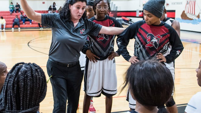 Northside girls basketball head coach Amy DesOrmeaux meets with her team during a break Friday Jan. 5, 2018.