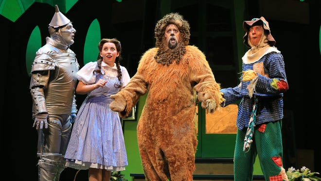 """The Tin Man, Dorothy, Cowardly Lion and Scarecrow find all sorts of adventures along the Yellow Brick Road in """"The Wizard of Oz."""""""