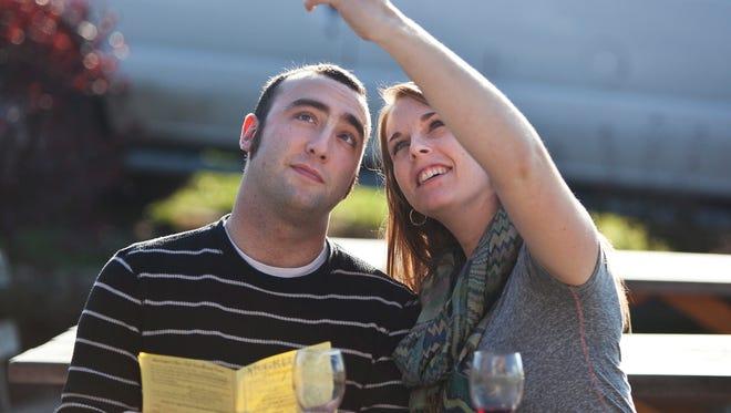 Guests at McGregor Vineyard sample wine in 2012.