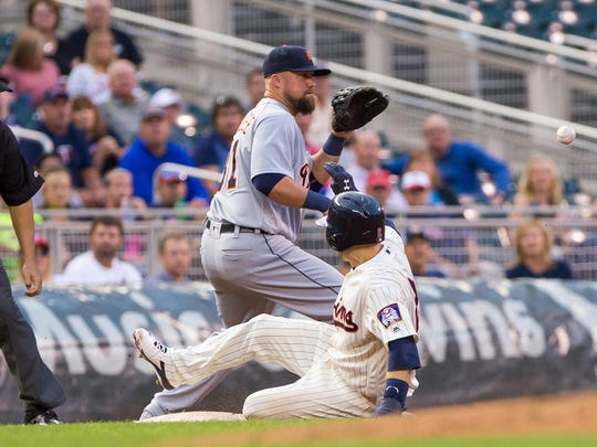 Minnesota Twins second baseman Brian Dozier (2) reaches third base on a sacrifice fly in the first inning Wednesday against Detroit Tigers third baseman Casey McGehee (31) at Target Field in Minneapolis.