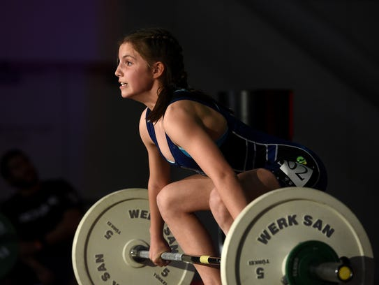 11-year-old Olivia Barclay competes in the Snatch event