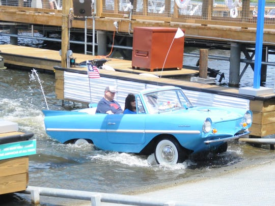 TIM WALTERS/FLORIDA TODAYA 1960s era Amphicar drives out of the lake behind the new Boathouse restaurant in Downtown Disney, which is transitioning to Disney Springs. A 1960s era Amphicar drives out of the lake behiond the new Boathouse restaurant in Downtown Disney, which is transitioning to its new name, Disney Springs. TIM WALTERS/FLORIDA TODAY