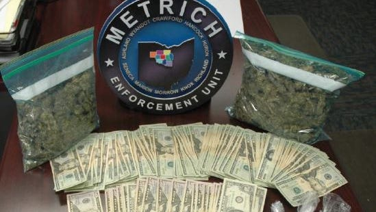 Officers from multiple law enforcement agencies raided a Plymouth residence Wednesday and found $9,000 cash as well as over $7,000 worth of prescription drugs, two pounds of marijuana, mushrooms and a gun.