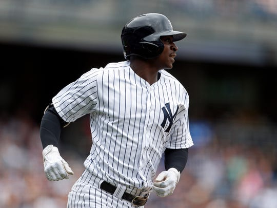 New York Yankees shortstop Didi Gregorius (18) watches a sacrifice fly against the Tampa Bay Rays during the second inning at Yankee Stadium on July 29 2017.