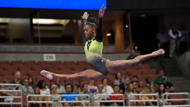 Trinity Thomas competes on the balance beam during women's opening round of the U.S. gymnastics championships, Friday, Aug. 18, 2017, in Anaheim, Calif. (AP Photo/Mark J. Terrill)