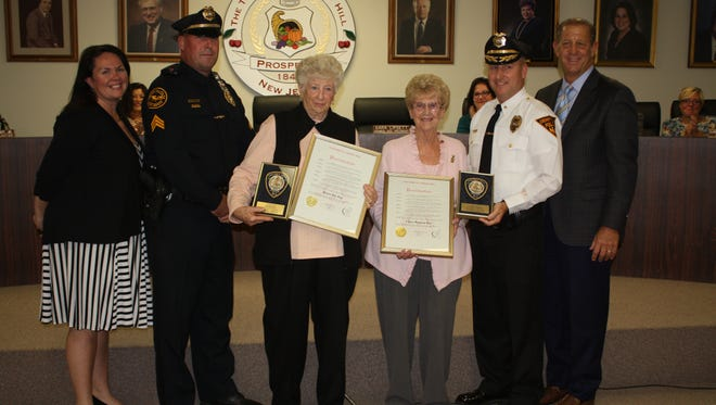 87-year-old Claire Bauman and 88-year-old Helen Nitz were honored Tuesday night for their combined 100 years of service as Cherry Hill crossing guards