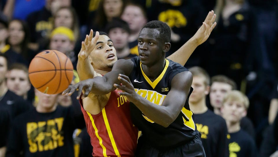Iowa guard Peter Jok, right, battles against Iowa State's