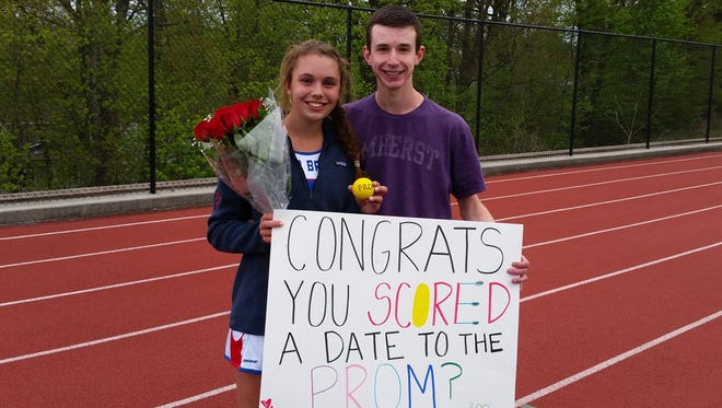 Blind Brook senior midfielder Mackenzie Korpi (left) poses with Josh Rosson, whom she accepted a promposal from, after her team's 7-6 win over Sleepy Hollow at Blind Brook High School on Thursday, April 28th, 2016.