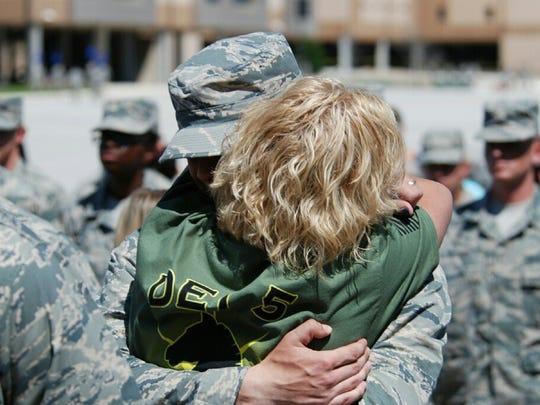 Kimberly Knapp hugs her son, Cameron Shapiro.