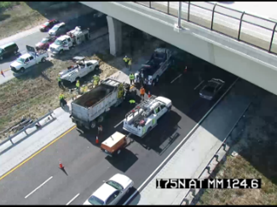 A tire blowout caused a semi-truck to collide with a lunch truck on I-75 under the Estero Blvd. overpass. Two people were injured and transported to the hospital.