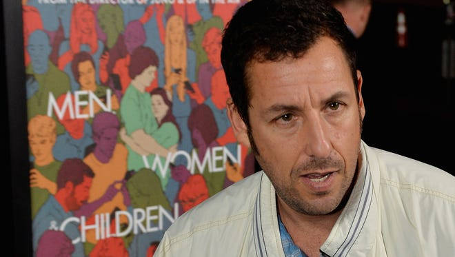 """Actor Adam Sandler attends the Los Angeles premiere of the Paramount Pictures' movie 'Men, Women & Children' at the Directors Guild of America in Los Angeles on September 30, 2014. For the second year in a row, Forbes magazine declares Adam Sandler the """"most overpaid"""" actor in Hollywood, meaning his movies bring in the lowest return on investment."""