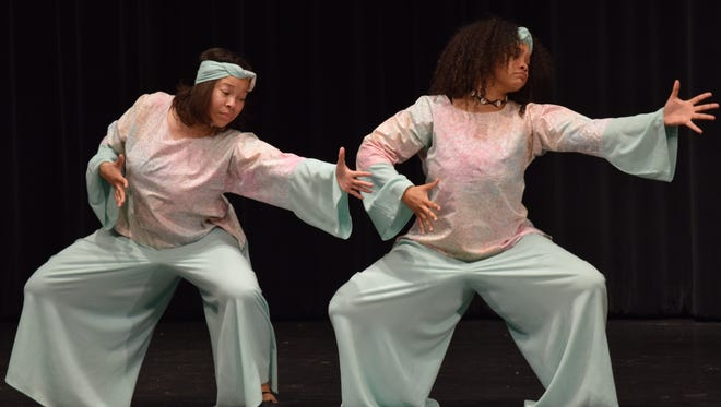 Two dancers from the Jelani Performers troupe dance during the entertainment section of the 13th Black Heritage Dinner at Ohio State University Newark Feb. 25.