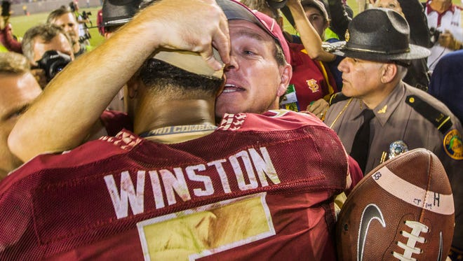 Florida State coach Jimbo Fisher talks with quarterback Jameis Winston after FSU defeated Notre Dame 31-27 on Saturday.