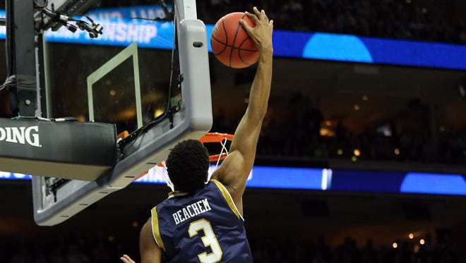 Mar 27, 2016; Philadelphia, PA, USA; Notre Dame Fighting Irish forward V.J. Beachem (3) dunks against the North Carolina Tar Heels during the first half in the championship game in the East regional of the NCAA Tournament at Wells Fargo Center. Mandatory Credit: Bill Streicher-USA TODAY Sports