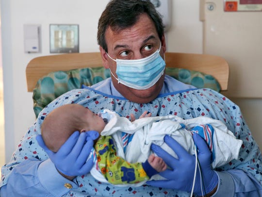 New Jersey Gov. Chris Christie holds a 49-day-old baby