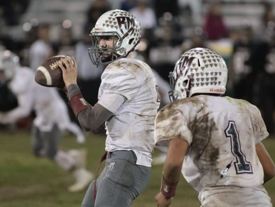 Rancho Mirage quarterback David Talley carries the