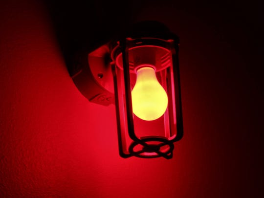 A red light shines in the Fallout Shelter - one of Think in a Box's escape rooms.