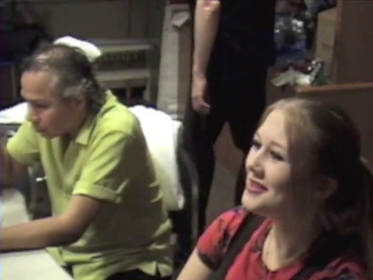 In this video still, Sam Llanas of the BoDeans and Tessa Neumann are seen sitting side by side in the green room the night of a 2005 show in Minnesota. In a Journal Sentinel report, Tessa Neumann, the stepdaughter of band co-founder Kurt Neumann, said Llanas molested her for years as a child. In a radio interview, Llanas said he didn't really know Tessa until she was 17 when she went on tour with the band. She was 13 when this video was taken.