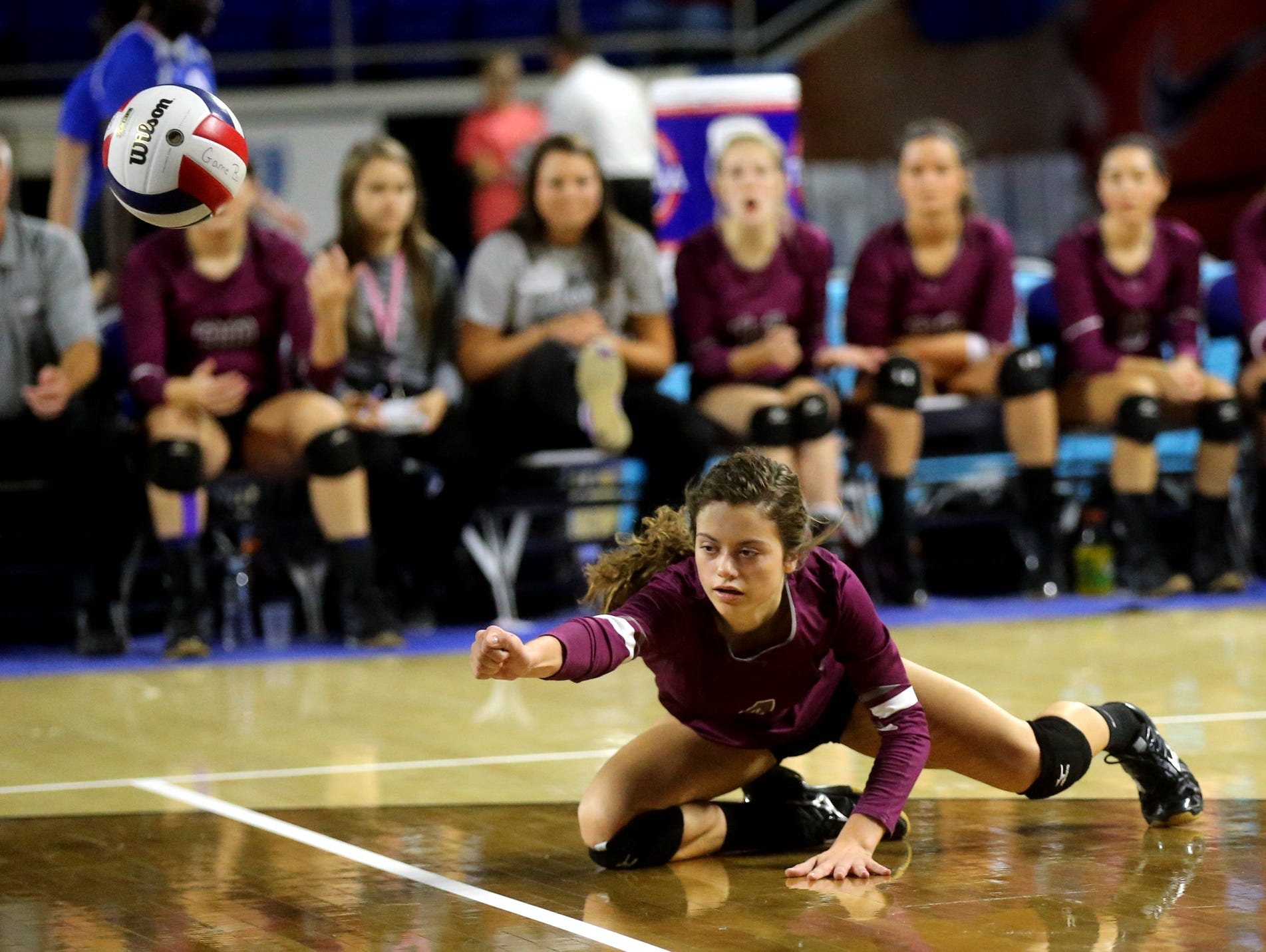 Eagleville's Abby Creech (4) dives for a ball during the losers bracket game of the TSSAA Class A state volleyball tournament against Summertown, on Thursday, Oct. 22, 2015, at MTSU.