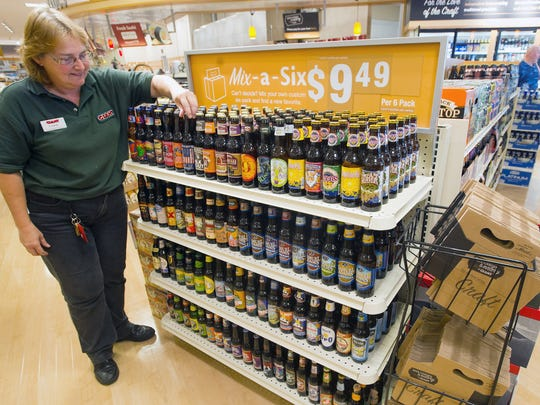 Fran Welsh arranges bottens in a Mix-a-Six display at the Springettsbury Township Giant in 2012. Giant plans to open another beer garden in Shrewsbury borough.